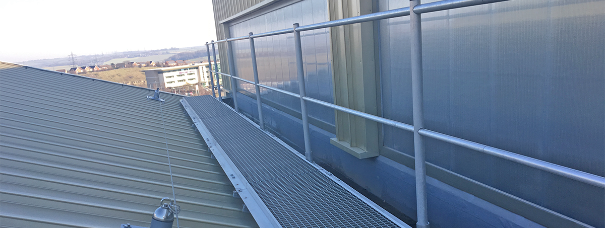 Ascent aluminium roof walkway levelled with handrail to one side to standing seam roof